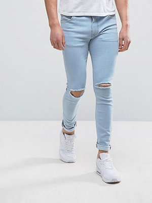 ASOS Super Skinny Jean With Knee Rips In Bleach Blue - Heavy bleach