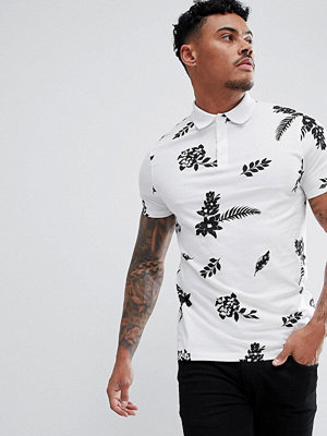 ASOS DESIGN polo with all over floral print