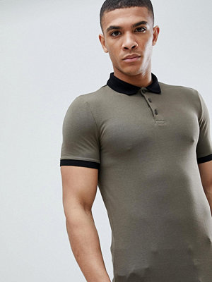 ASOS DESIGN muscle fit polo in jersey with contrast collar and curved hem - Camo khaki/ black
