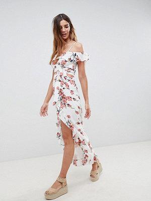 Glamorous Romantiskt blommig kjol i maxilängd med volangkant nedtill och slits framtill