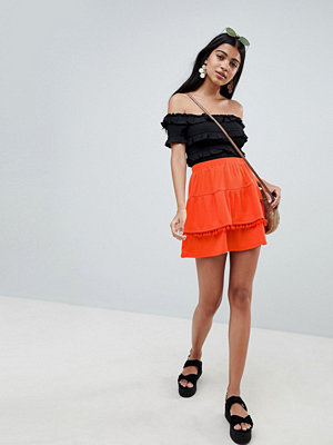 ASOS DESIGN lace insert and pom pom mix mini skirt