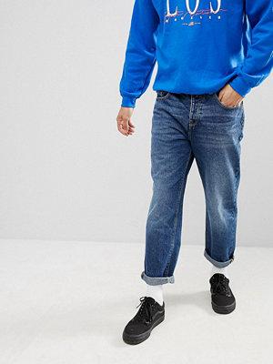 ASOS DESIGN skater jeans in mid wash blue - Dark wash blue