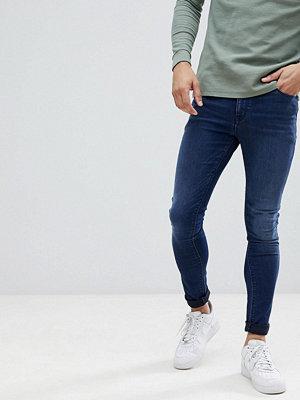 ASOS DESIGN Super Spray On Jeans In Dark Wash Blue - Dark wash blue