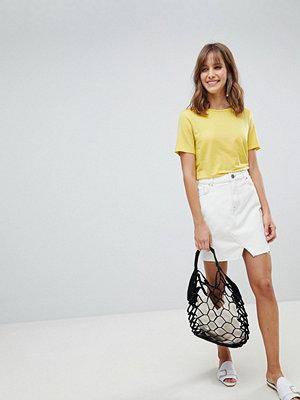 ASOS DESIGN denim pelmet skirt in off white and tobacco stitch
