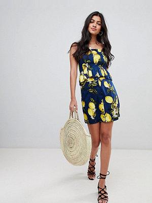 Glamorous Kjol med knäppning i citronmönster