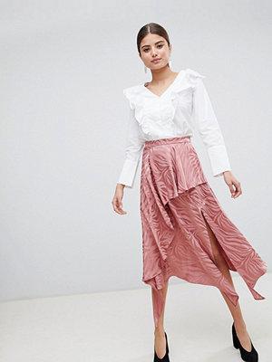 ASOS DESIGN soft jacquard midi skirt with asymemetric hem - Dusty pink