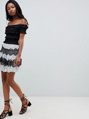ASOS DESIGN polka dot mini skirt with lace inserts - Mono spot