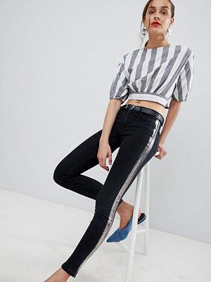 Mango Jeans med folierand i svart