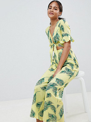 Asos Tall ASOS DESIGN Tall jumpsuit with cut out and tie detail in linen leaf print - Leaf print