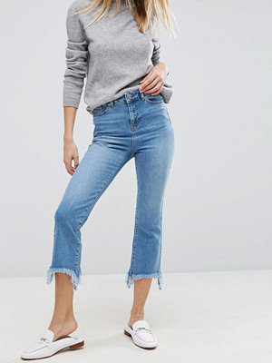 ASOS Cropped Flare Jeans in Mid Stonewash with Arched Hem - Mid stone wash
