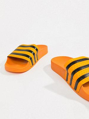 Adidas Originals Adilette Slider Sandals In Orange - Orange