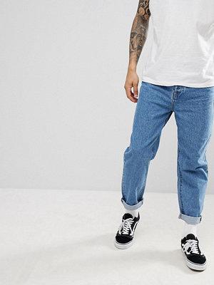 ASOS DESIGN Skater Jeans In Mid Wash Blue - Indigo
