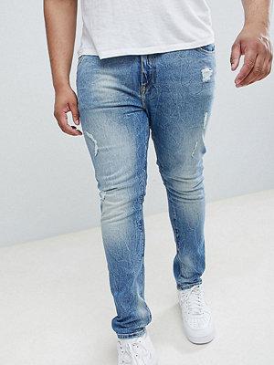 ASOS DESIGN Plus super skinny jeans in mid wash vintage blue with abrasions - Mid wash vintage