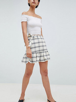 ASOS DESIGN mini skirt with side buttons in check - Multi