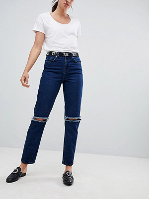 ASOS DESIGN Ritson rigid mom jeans with 90S waistband & super ripped knees - Mid wash blue