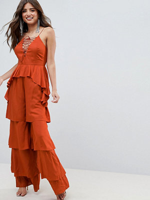 ASOS DESIGN Tiered Jumpsuit With Lace Up Front - Rust