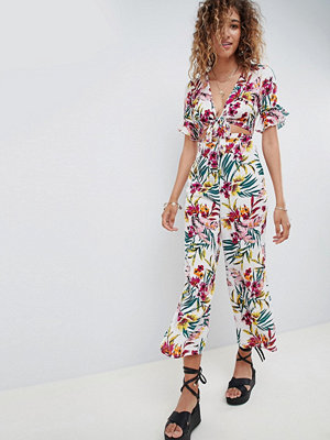 ASOS DESIGN tea jumpsuit with cut out and tie detail in tropical print - Tropical print