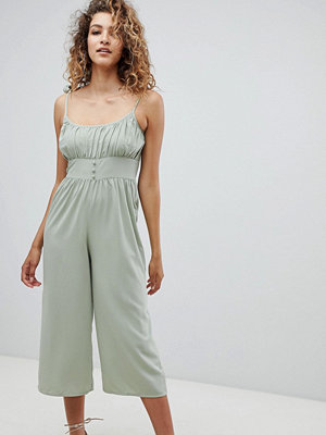 ASOS DESIGN jumpsuit with tie cami straps and pleat detail - Light green