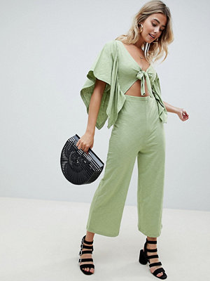 ASOS DESIGN kimono jumpsuit with cut out and tie front in slub jersey - Light green