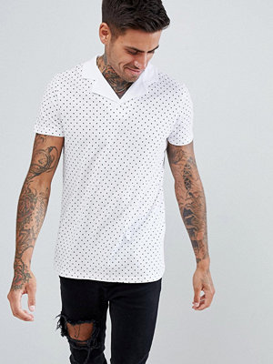 ASOS DESIGN polo with all over polka dot print and revere collar