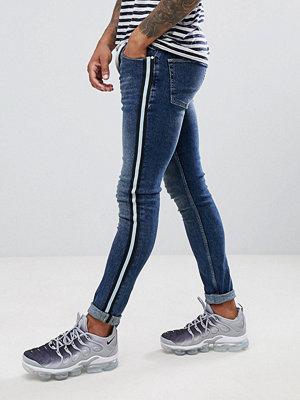 ASOS DESIGN super skinny jeans in dark wash blue with side stripe - Dark wash blue