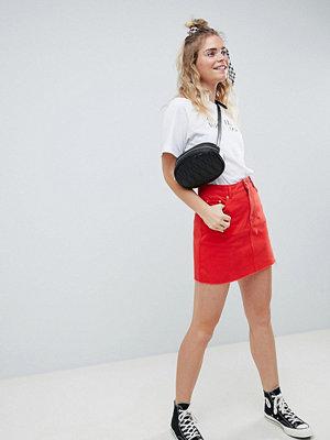 ASOS DESIGN denim mini skirt