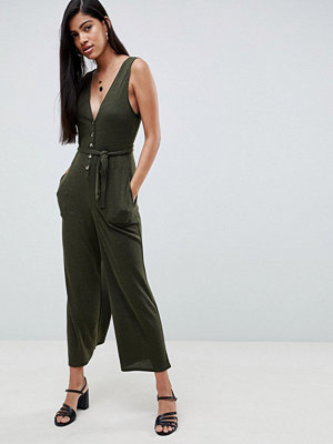 ASOS DESIGN V neck jumpsuit with button front in slouchy rib