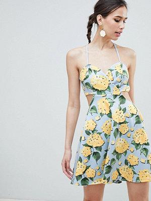 ASOS DESIGN strappy babydoll mini dress in floral print - Blue based floral