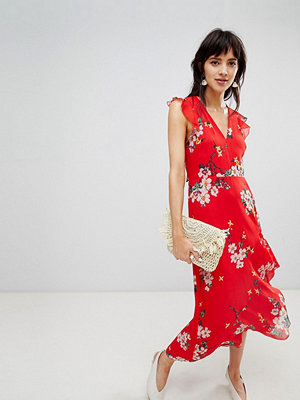 Warehouse midi dress with ruffle detail in floral print