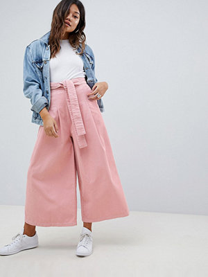 ASOS DESIGN wide leg in pink cord with waist tie