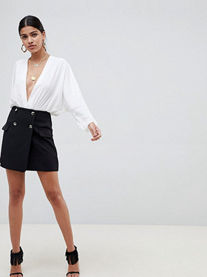 ASOS DESIGN double breasted tux mini skirt with satin pockets