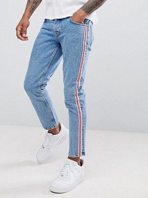 ASOS DESIGN slim jeans in mid wash blue with pink side stripe - Mid wash vintage