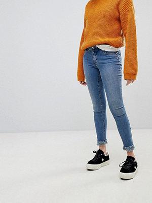 Only Skinny jeans med sliten fåll Ljusblå demin