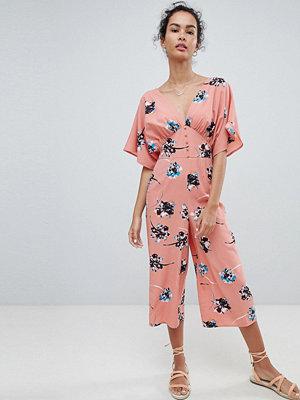 ASOS DESIGN Sommarjumpsuit med kimonoärm och knappdetaljer i blommigt mönster Rosa blommigt