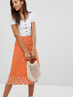 Asos Tall ASOS DESIGN Tall polka dot print midi skirt with embroidered hem - Orange/white
