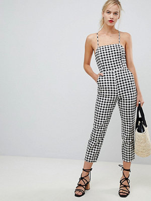 ASOS DESIGN denim jumpsuit with strappy back in gingham - Black/ white