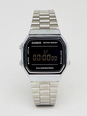 Klockor - Casio A168W Digital Bracelet Watch In Silver/Black Mirror