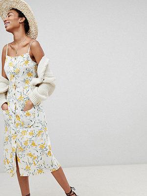 Asos Tall ASOS DESIGN Tall button through linen midi sundress in floral print