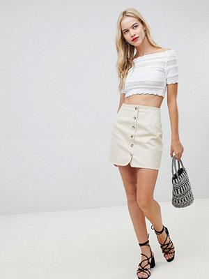 ASOS DESIGN denim skirt with tortoiseshell buttons