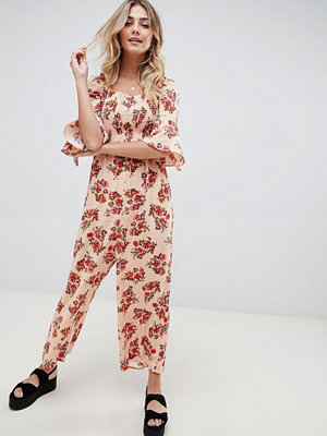 ASOS DESIGN jumpsuit with shirred bodice in ditsy floral print - Blush floral
