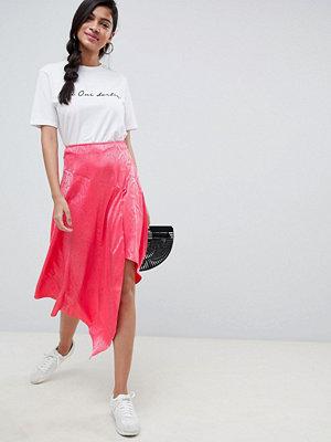 ASOS DESIGN pink snake jacquard midi skirt with asymmetric hem