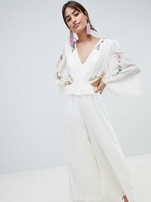 ASOS DESIGN cut out jumpsuit with soft ruffles and embroidery