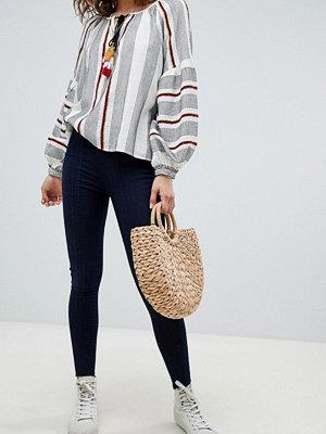 Free People Seamed pull on Skinny jeans Mörk denim