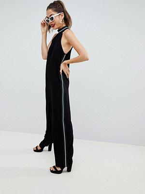 ASOS DESIGN halter jumpsuit with side stripe