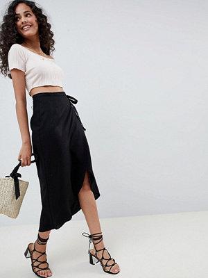 ASOS DESIGN wrap midi skirt with tie