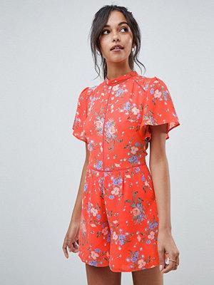 Oasis playsuit with ruffle sleeves in orange floral print