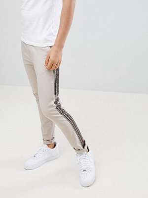ASOS DESIGN skinny trousers in beige with aztec side taping - Mushroom