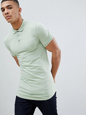 ASOS DESIGN longline muscle fit polo with curved hem in green - Meadow green