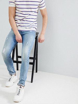 ASOS DESIGN super skinny jeans in mid wash vintage blue with abrasions - Mid wash vintage