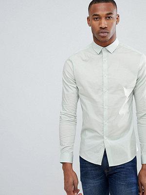 ASOS DESIGN skinny shirt in light green
